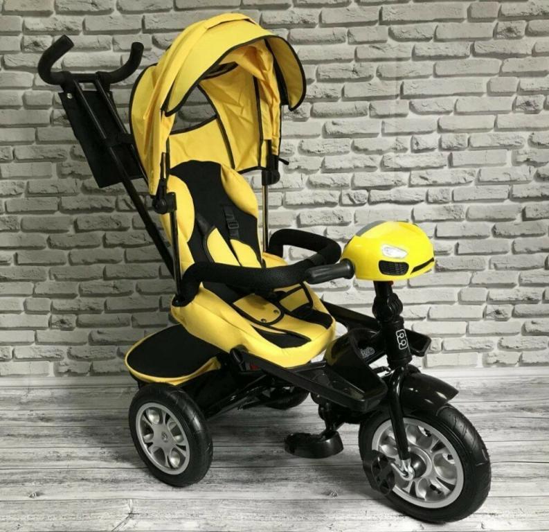 Велосипед трехколесный ткань лен, поворотное сиденье,музыка,надувные колеса цвет желтый